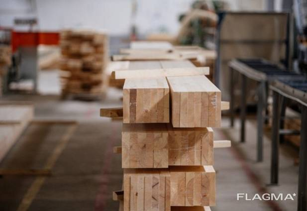 Glued profiled beam, glued laminated timber